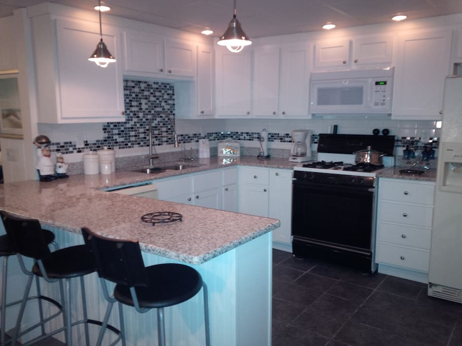 Newly remodeled kitchen with granite countertops and many other upgrades