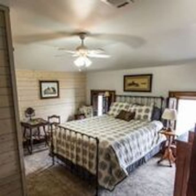 The iron bed frame is original to this home from 1880 however the mattress is a comfy new memory foam.