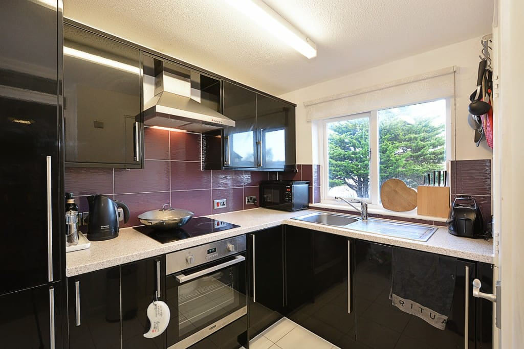 modern kitchen with hobs, fridge freezer, microwave, kettle, all Bosch producs.  also with a Bosch washer dryer