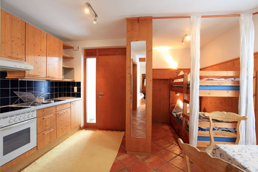 entry, kitchen and bunk beds