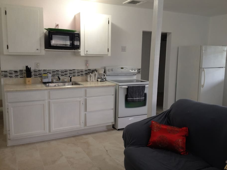 Full kitchen with all amenities for cooking meals or just reheating.