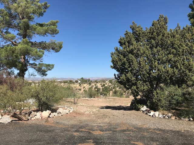 Your driveway with fabulous views of the valley & Sedona in the background.  We are still working on this area & hope to have a medicine wheel, picnic area & sweat lodge in the future.