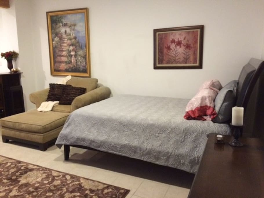 Comfortable queen size bed, plush lounger and mini bar.