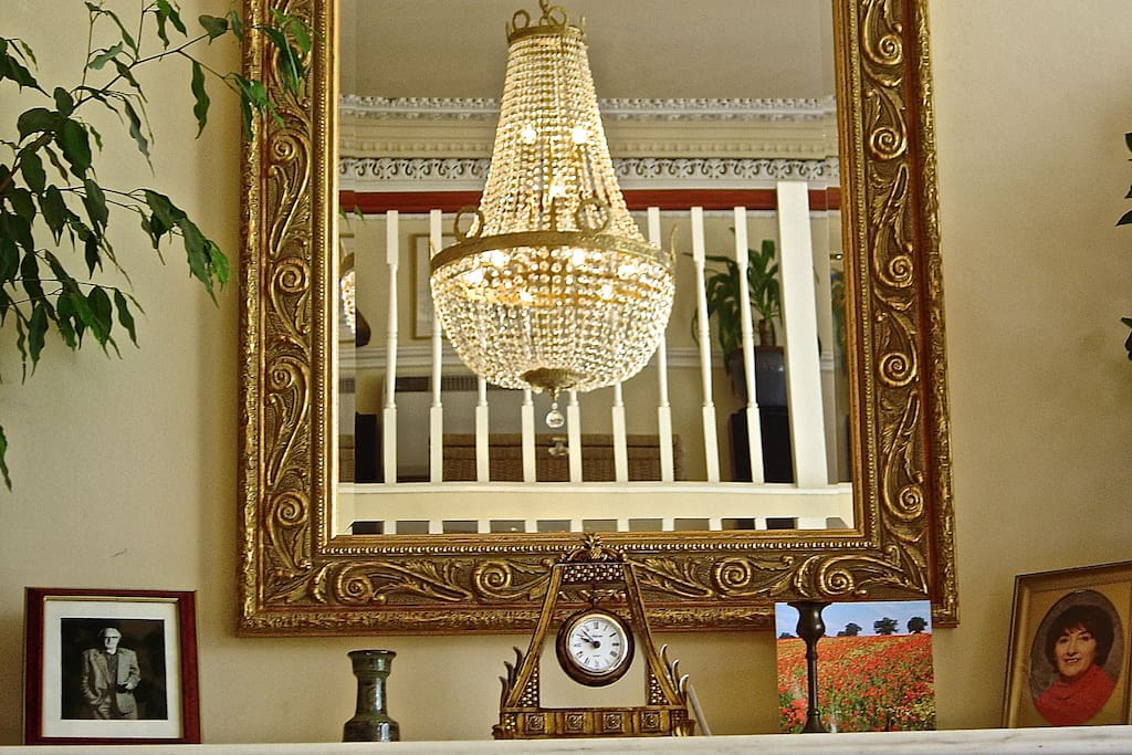Crystal chandelier and reflected upper gallery.