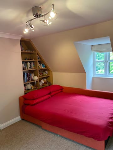 Large family bedroom on 2nd floor with access to shower room. Two beds/sleeps up three adults or children. Room for cot as well if wished (not provided.)