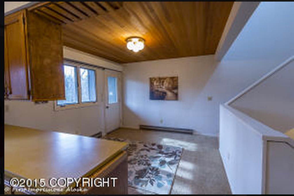Dining area, and stairs leading to 4th floor.