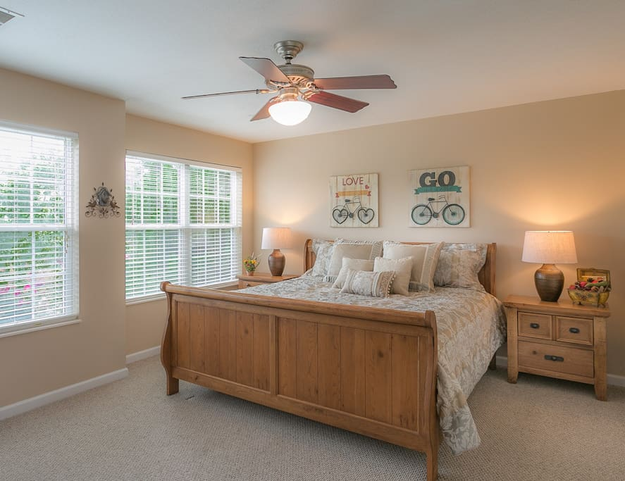 Master bedroom with private full bath and large Flat Screen TV on armoire with cable.