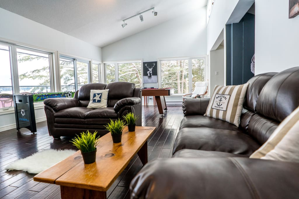 "The Great Room has it all: space for everyone to unwind, 65"" TV, stereo, pool table, foosball, DVDs, books, and the most spectacular views of Sparrow Lake!"