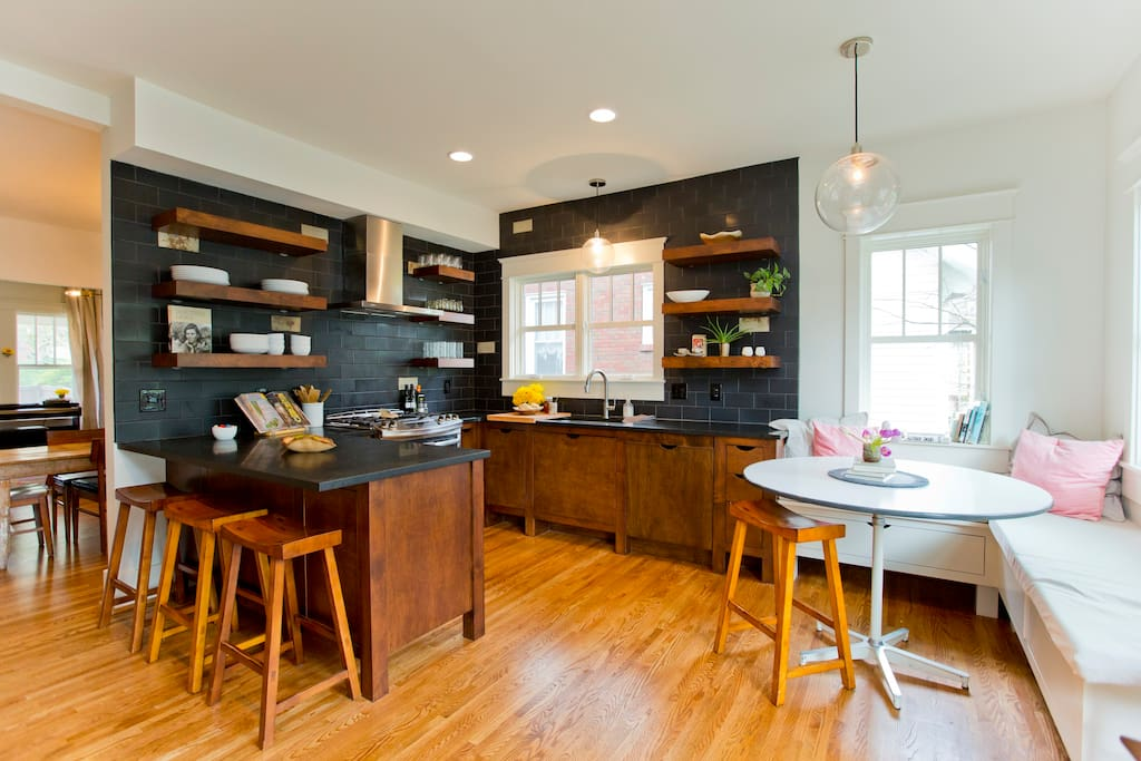 Kitchen with gas stove, dishwasher, and banquette.
