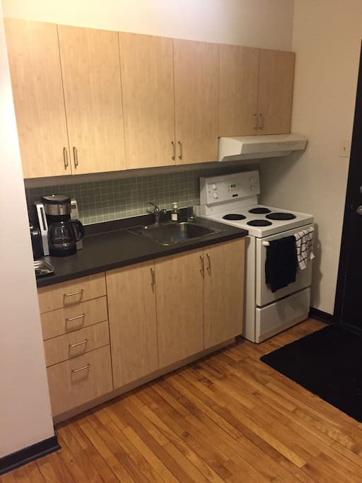 All equipped kitchen with a microwave, toaster, coffee machine and way more
