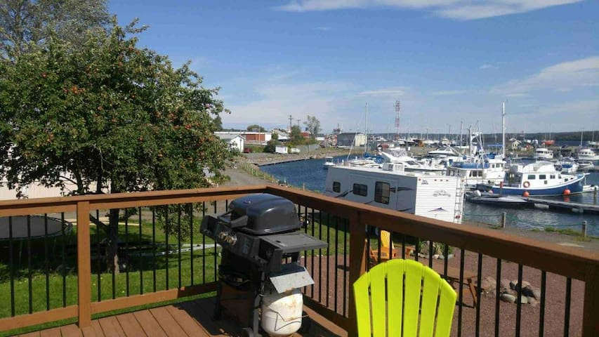Back deck with seating area and BBQ