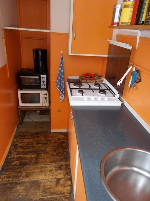 The kitchen with stove, microwave and oven