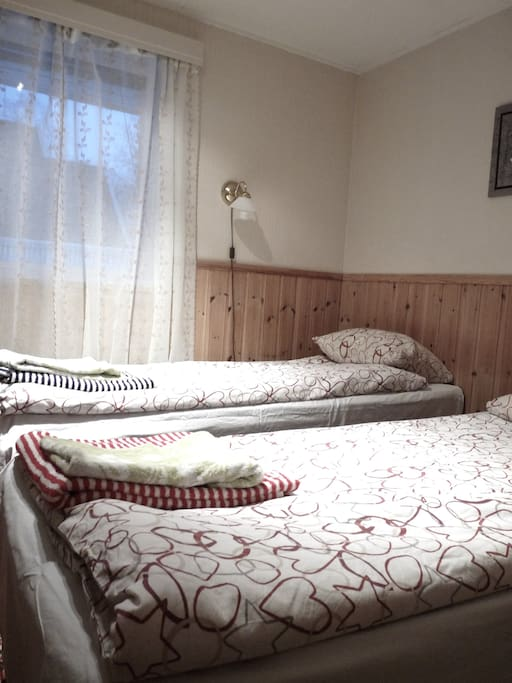 1 of 2 big bedrooms with 2 beds, TV and wardrobe