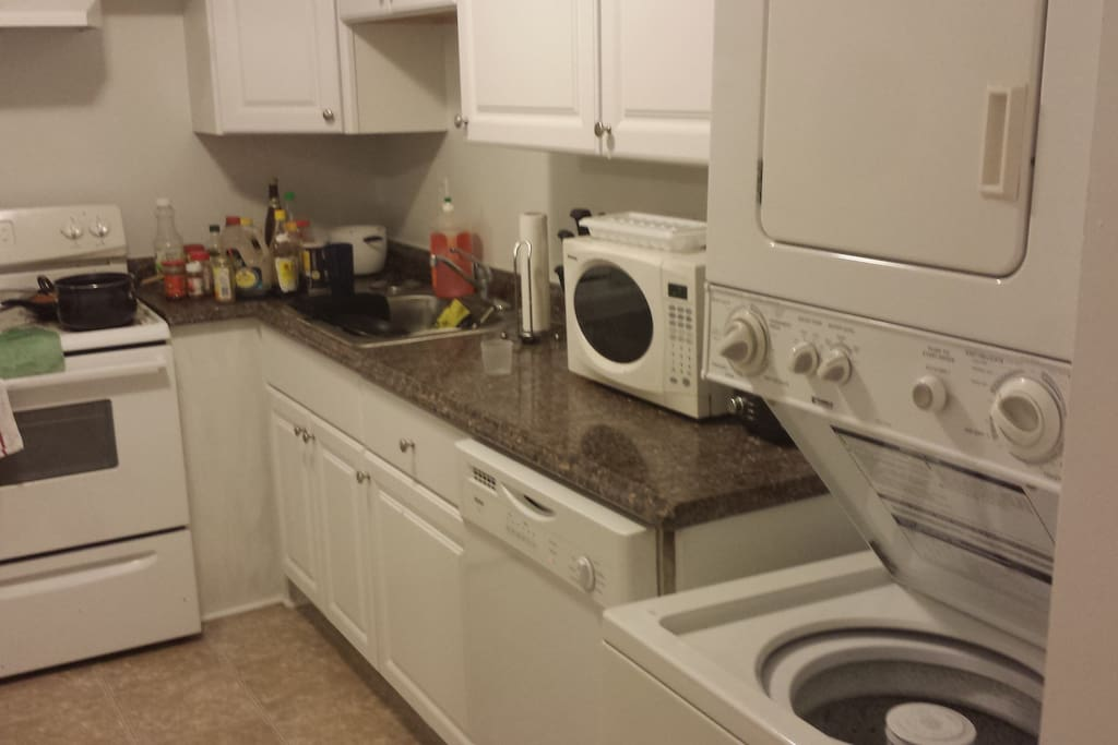 kitchen with microwave, washing machine and dryer