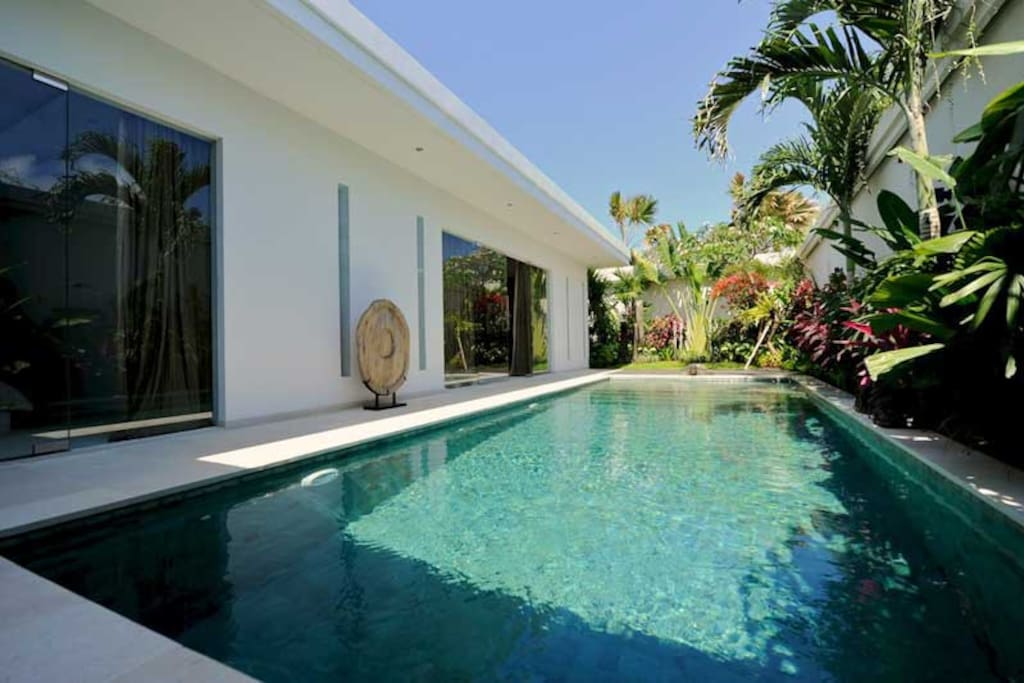 Pool view and bedrooms from the terrace of villa Kallayaan.