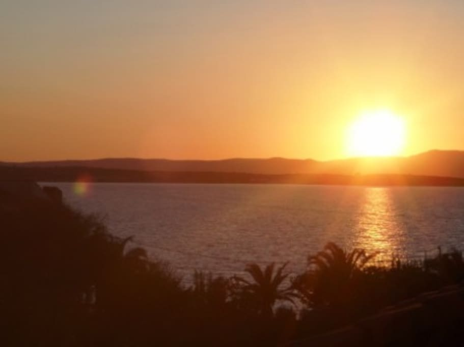 Perfect sunset behind Chios, Greek Island, from the Roof Terrace