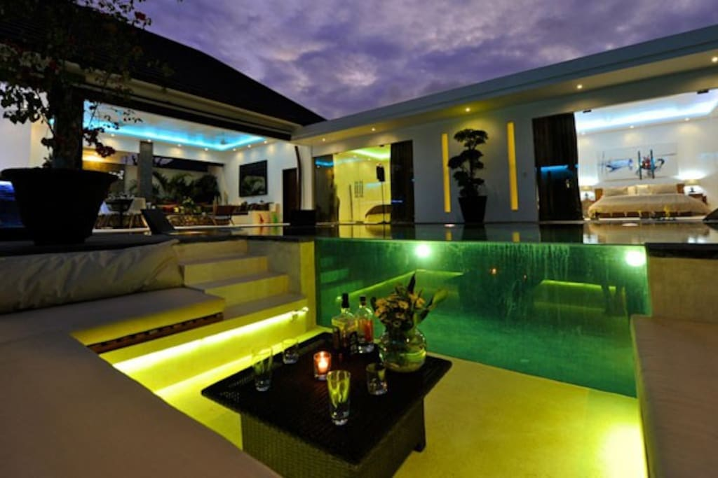 Cozy living room with pool view in villa Cantik. Perfect place to enjoy your coktail!