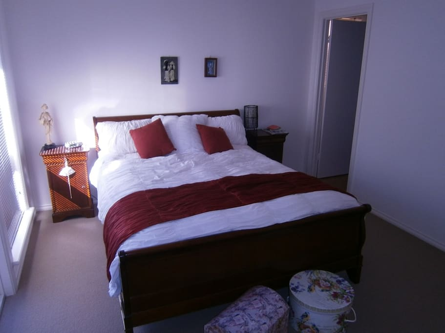 Main bedroom with ensuite and walk in robe QS Bed