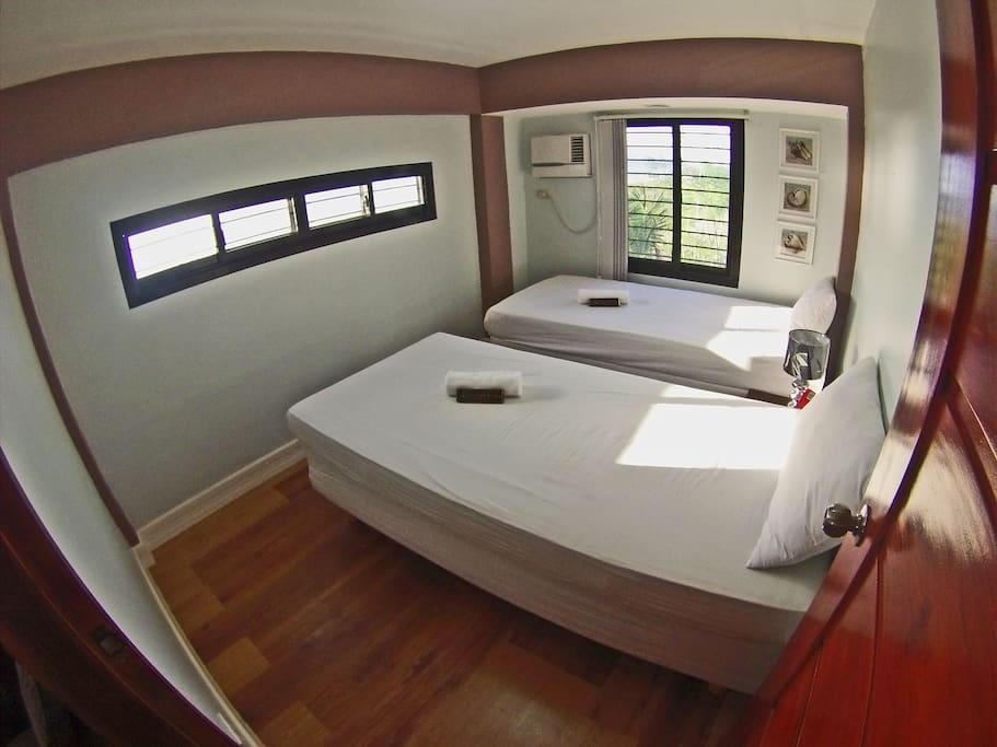 One of the upstairs bedrooms faces the sea and features two beds and air conditioning.