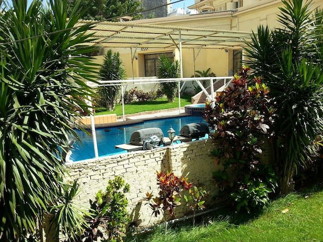 Sunny room in villa with pool