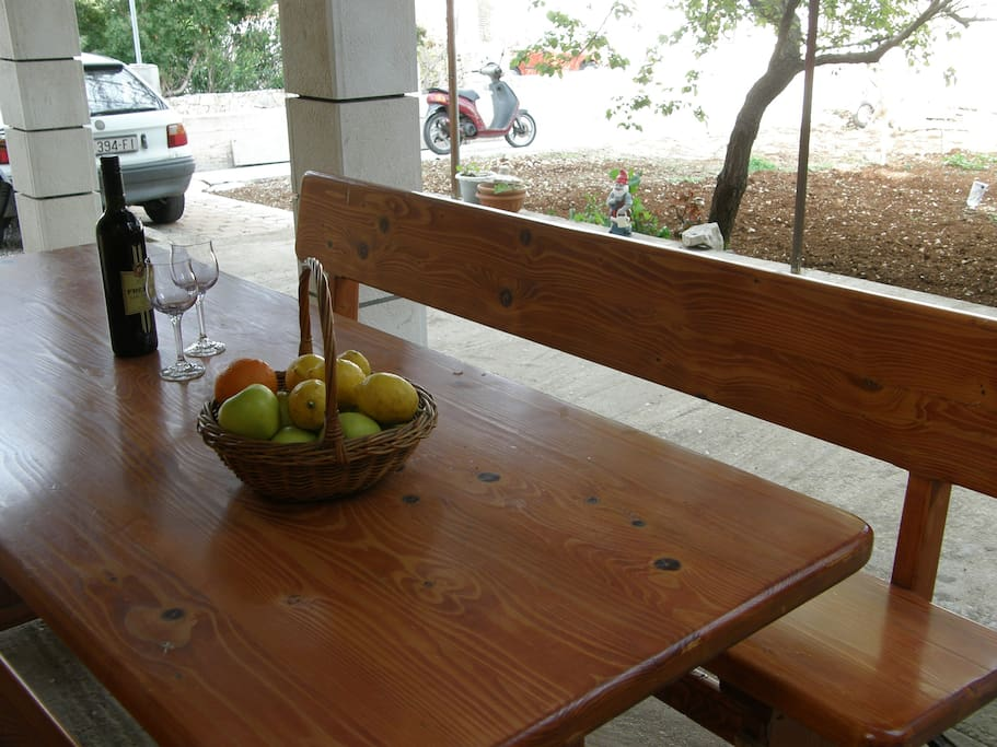Table on terrace in front of apartment