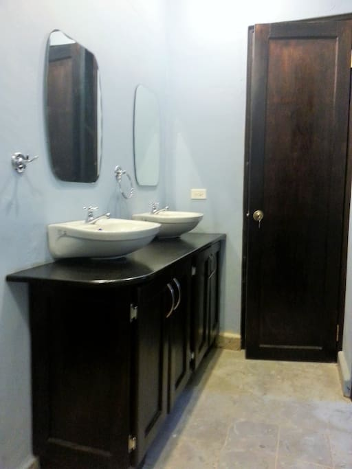 The shared sinks outside of the shower area is handy for rooms #1-3