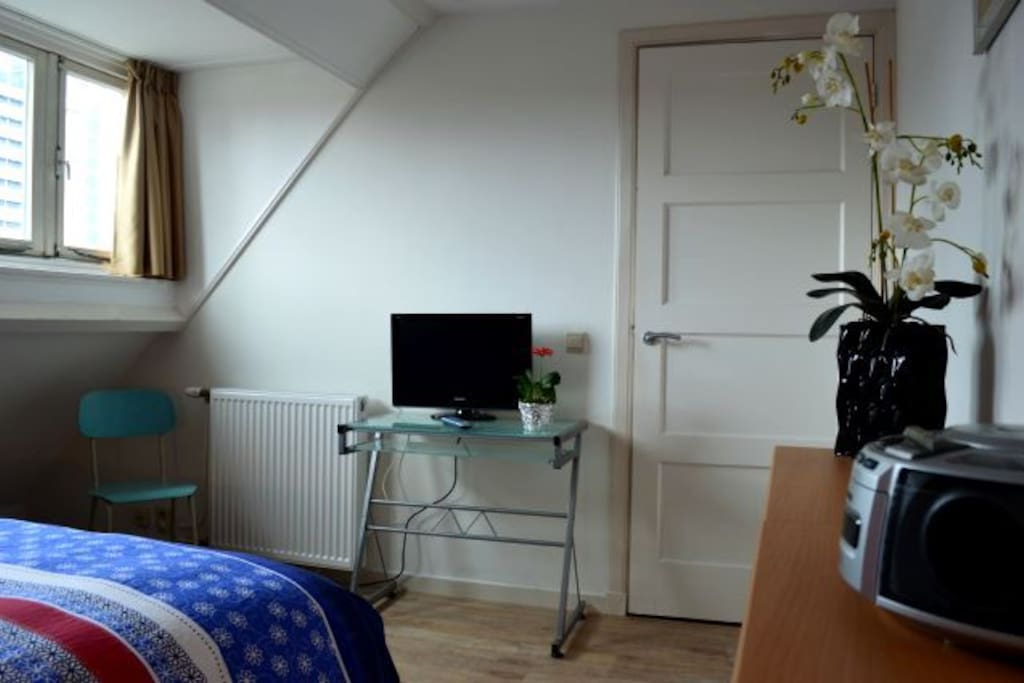 Cosey room with TV.