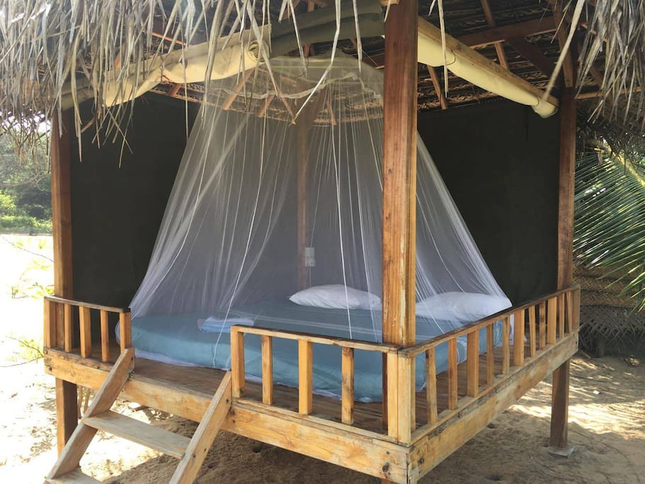 The bed and mosquito net in the kiosk