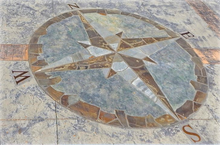 Pilots compass layed in stamped concrete driveway.
