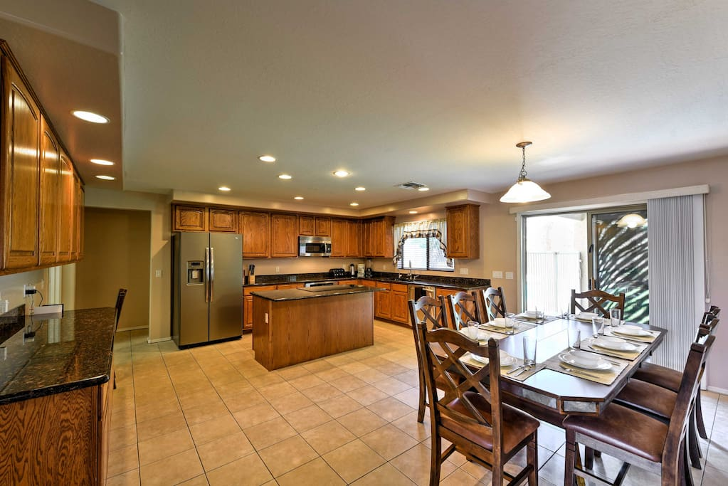 The chef of the group will delight in the spacious kitchen, complete with ample counterspace and a dining table to serve their home-cooked meals!