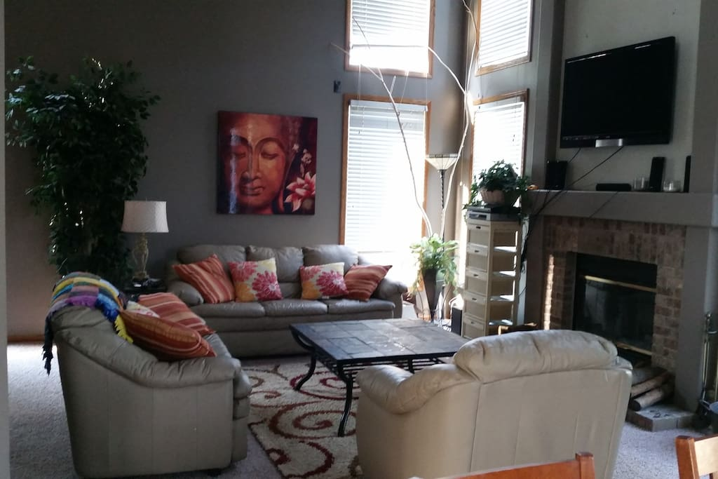 Living room with cathedral ceilings, big screen tv.