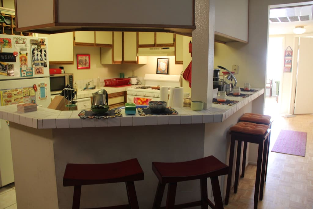Open kitchen with bar stools