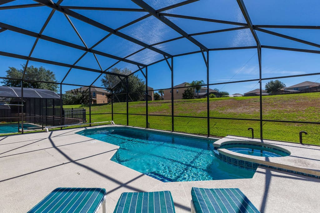 This extended pool deck soaks in the Florida sunshine - but the screened enclosure keeps out the bugs for comfortable sunbathing all day long.