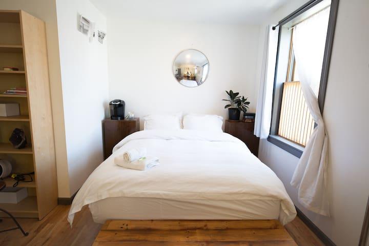 Queen-sized luxury mattress with in-room Keurig machine.