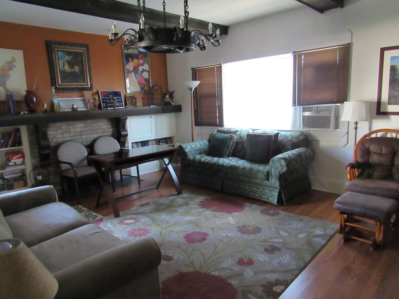 Great downtown charm in living room with local football décor