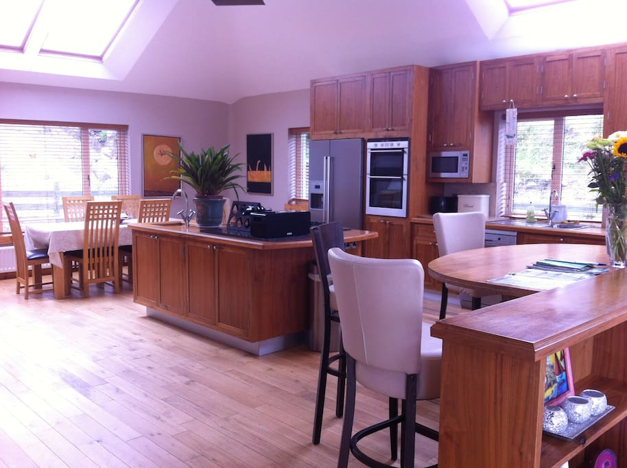 kitchen and dining area with breakfast bar.