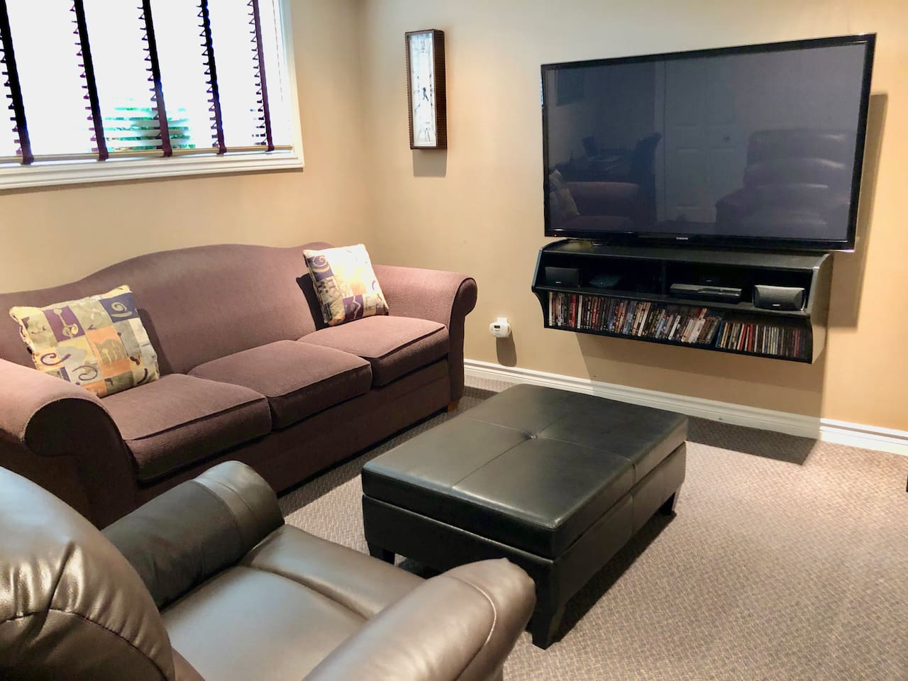 """Theatre Room with 55"""" T.V., Netflix, Sony Play Station, Bose Sound System and a fireplace make it a perfect place to kick back and relax."""