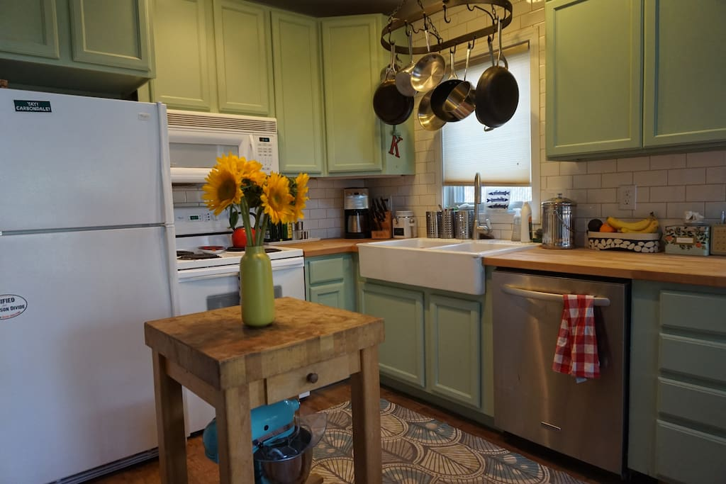 Open kitchen with dishwasher, range, kitchen and microwave.
