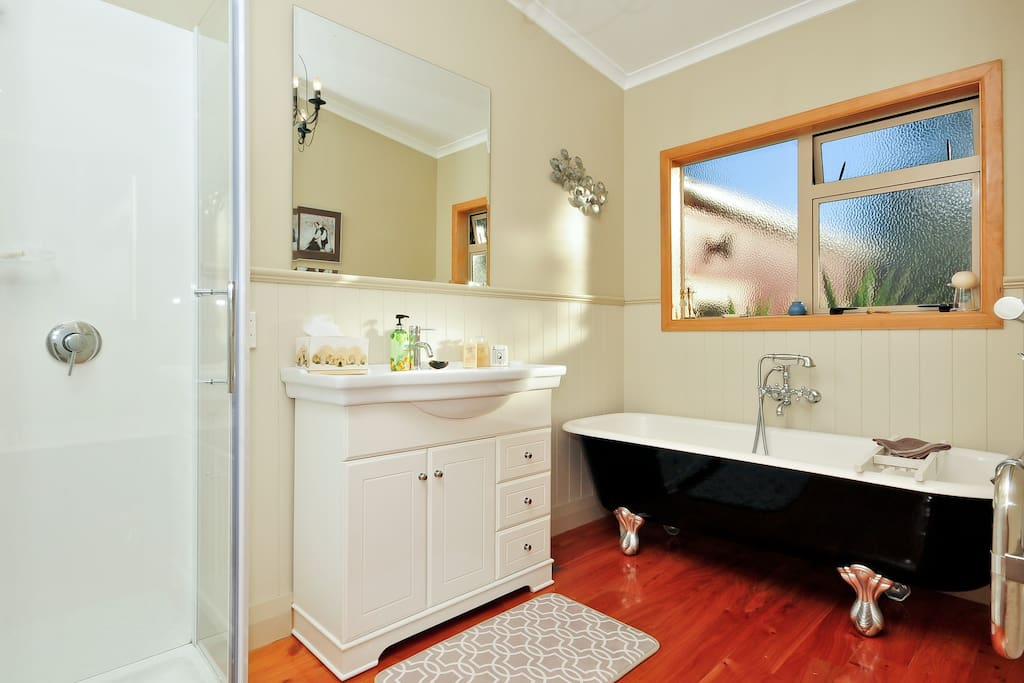 Your bathroom offers a shower, claw bath, heated towel rail, heater, hair dryer and polished wooden floor