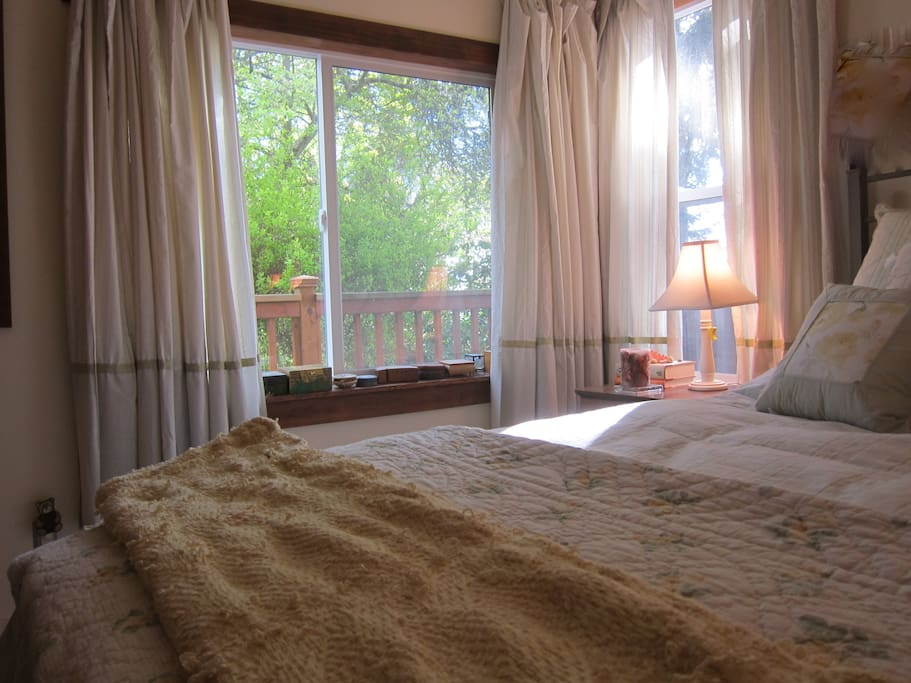 Guest bedroom, private view of green space, Puget Sound and Olympics mountains