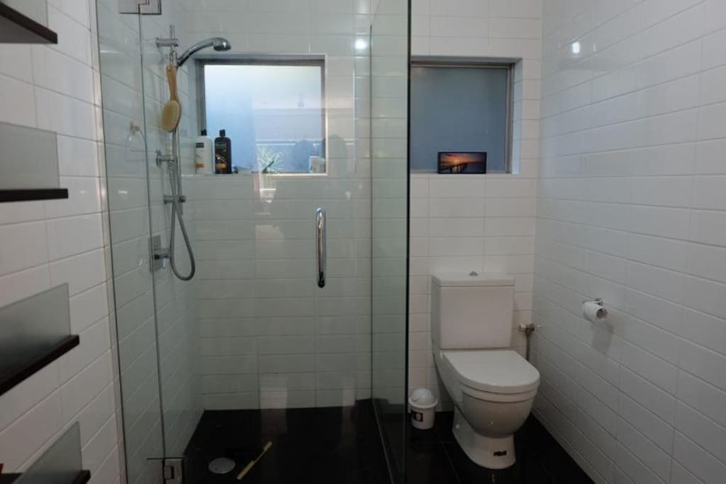 The clean separate bathroom with nice shower