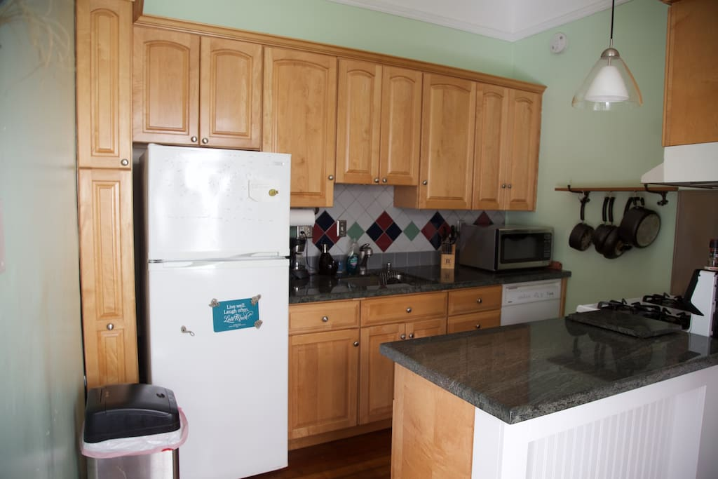 Kitchen with oven, microwave and coffee maker.