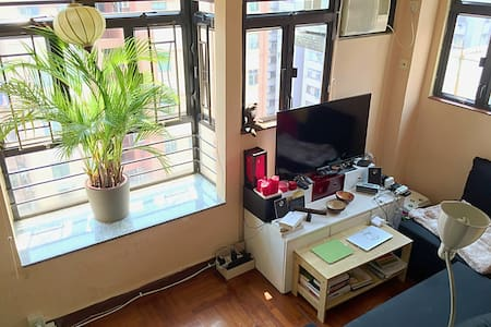 A truly cozy 1-bedroom apartment with a splendid rooftop terrace in the very local-feel district of Hung Hom (Kowloon Peninsula) right at the ocean.