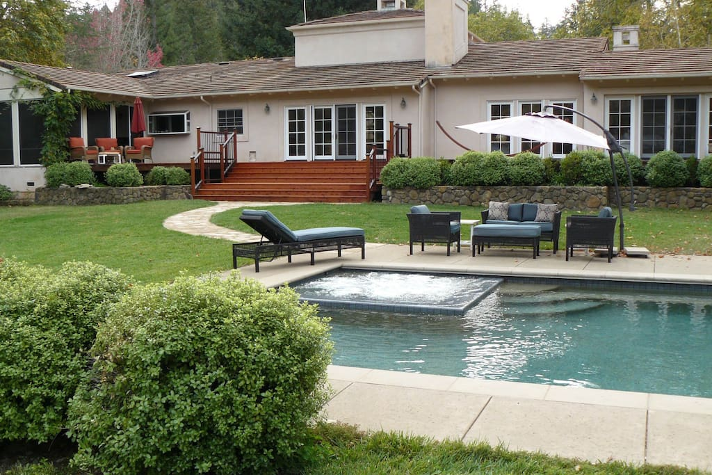 Seating around pool with jacuzzi jets running.  Wide staircase for gracious access to pool area.