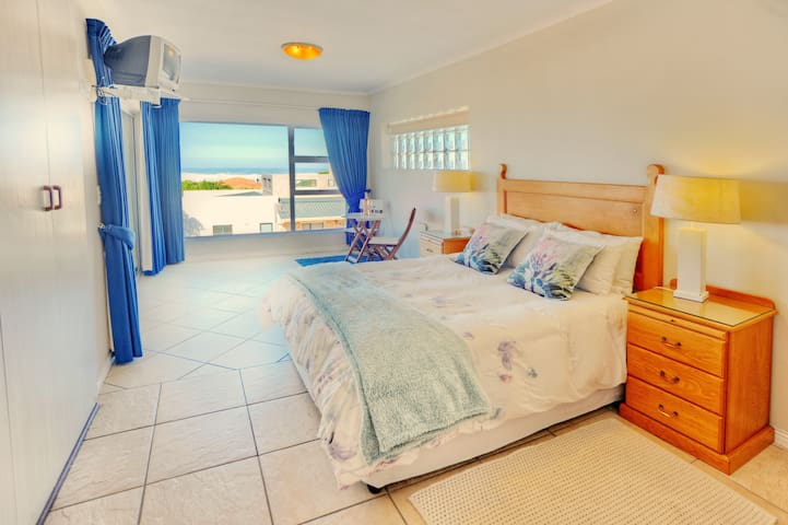 Spacious main bedroom with a view of the sea