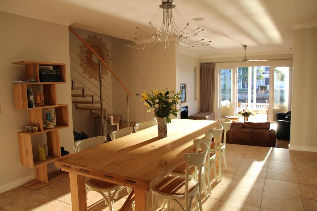 Open plan dining room which links  the kitchen with the lounge.  This beautiful walnut table seats 10
