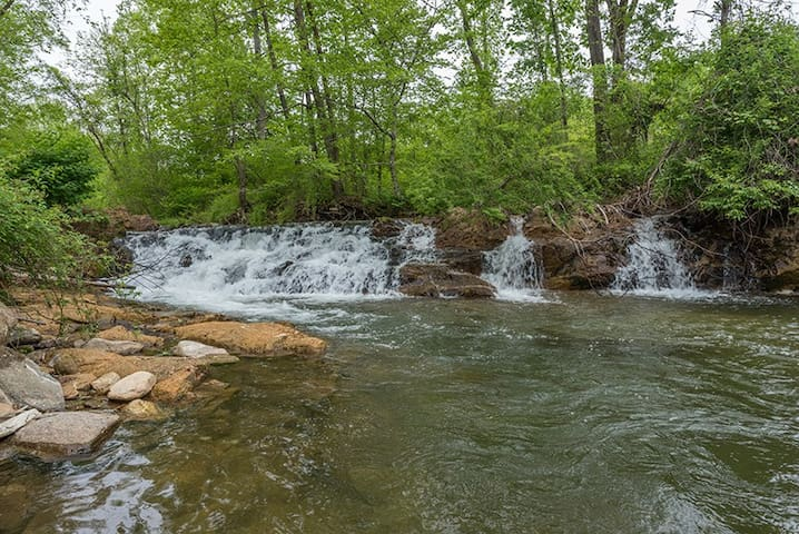 Waterfall and great swimming spot beside the fire pit for guests