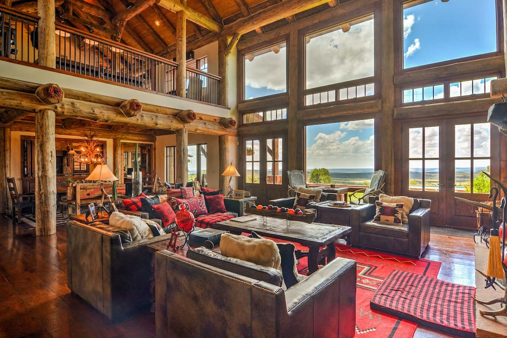 Upon entry, you'll be entranced with the custom interior's massive 30-inch logs, wide plank flooring and moss rock fireplaces.