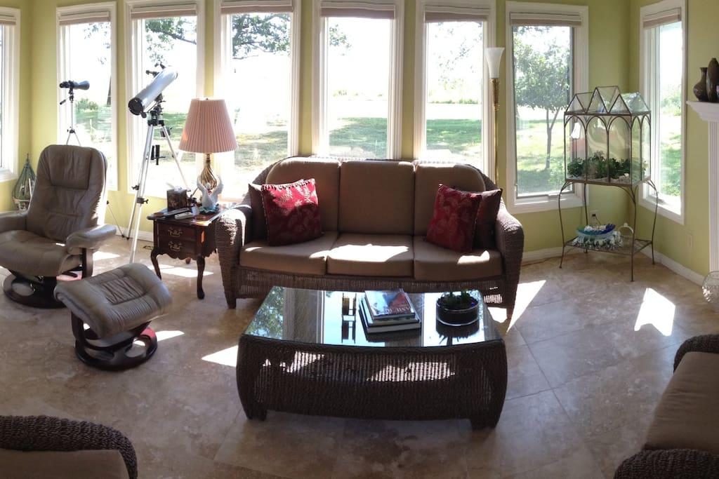 Panorama view of four season porch overlooking lake...