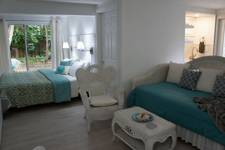 studio apartment bathed in natural light, view to your private patio
